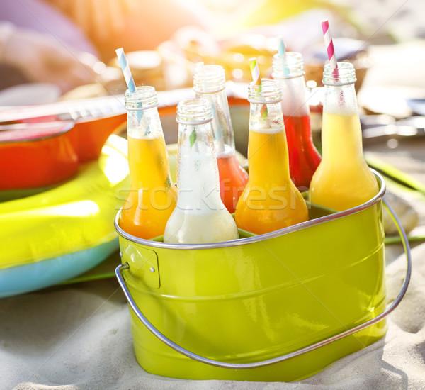 Bottles of lemonade standing in green bucket  Stock photo © dashapetrenko