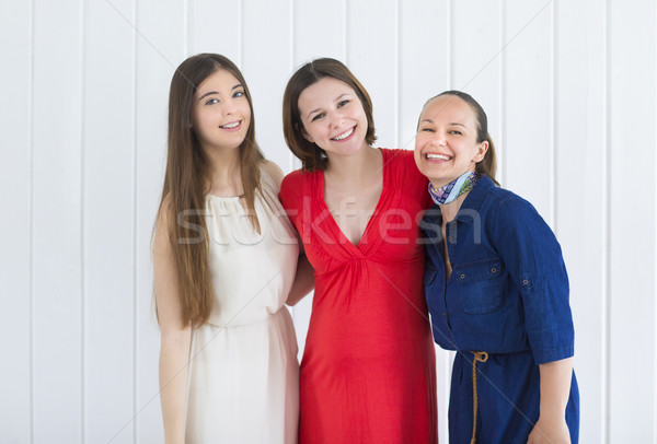 Happy female friends with pregnant woman  Stock photo © dashapetrenko