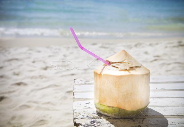 Fresh coconut cocktail on tropical beach Stock photo © dashapetrenko