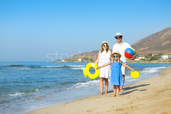 Stock photo: Happy young family having fun running on beach at sunset. Family
