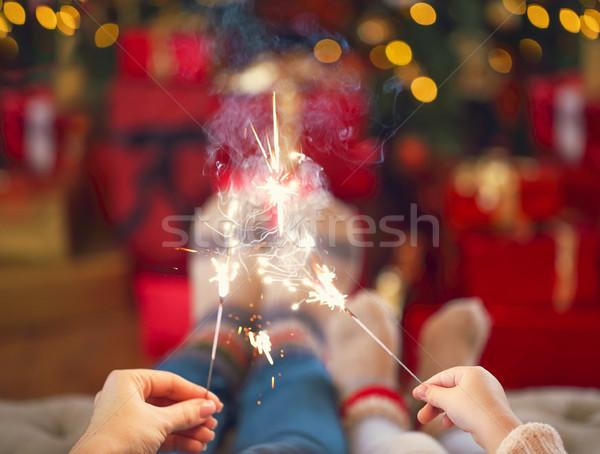 Szczęśliwą rodzinę bengalski światła christmas matka córka Zdjęcia stock © dashapetrenko