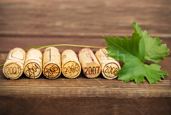 Dated wine bottle corks on the wooden background Stock photo © dashapetrenko