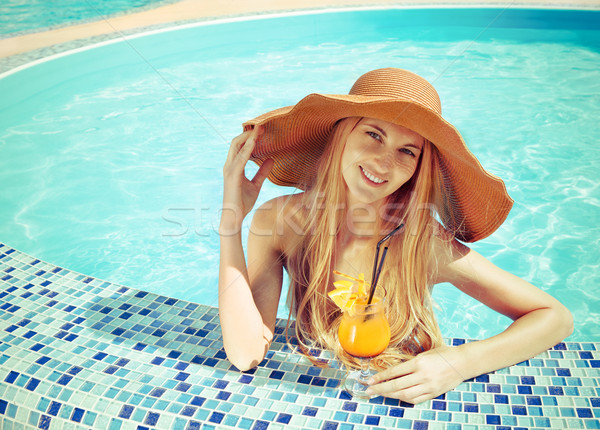 Pretty blond woman in a hat enjoying cocktail  Stock photo © dashapetrenko