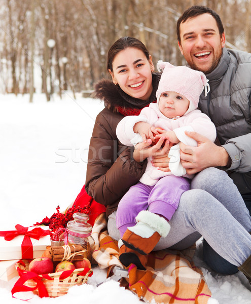 Happy smiling family with at the winter picnic  Stock photo © dashapetrenko