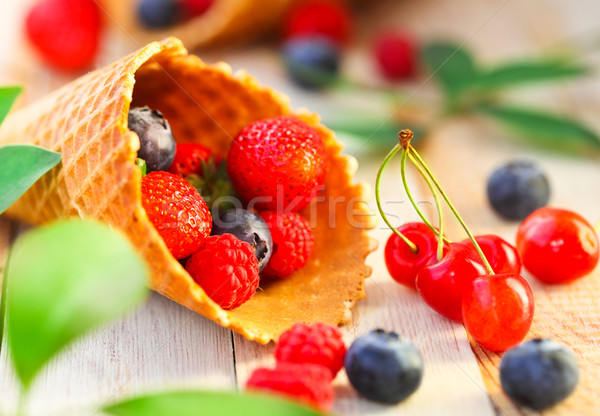 Wafer cups with strawberry, cherry, raspberry and blueberry Stock photo © dashapetrenko