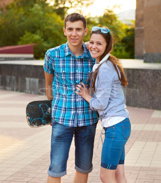 Young couple standing outdoors  Stock photo © dashapetrenko