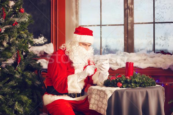 Santa Claus using a smart phone Stock photo © dashapetrenko