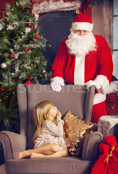 Littlle surprised girl and Santa Claus looking at her Stock photo © dashapetrenko