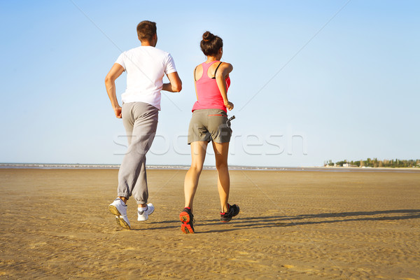 Runners training outdoors working out in nature against blue sky Stock photo © dashapetrenko