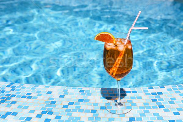Vidrio alcohol cóctel piscina naranja playa Foto stock © dashapetrenko