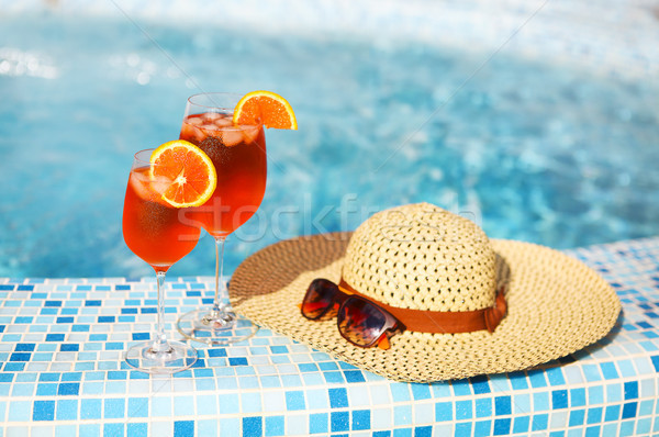 Glasses of orange alcohol cocktail on turquiose water background Stock photo © dashapetrenko