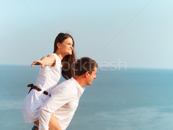 Young happy couple in love in summer day Stock photo © dashapetrenko