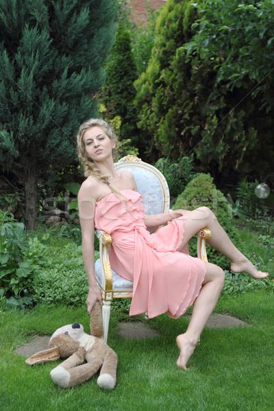 Beautiful girl in the garden Stock photo © dashapetrenko