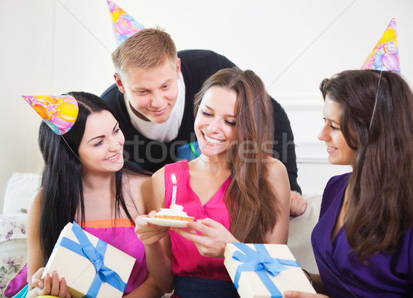 Joyful girl at birthday party surrounded by friends at party Stock photo © dashapetrenko