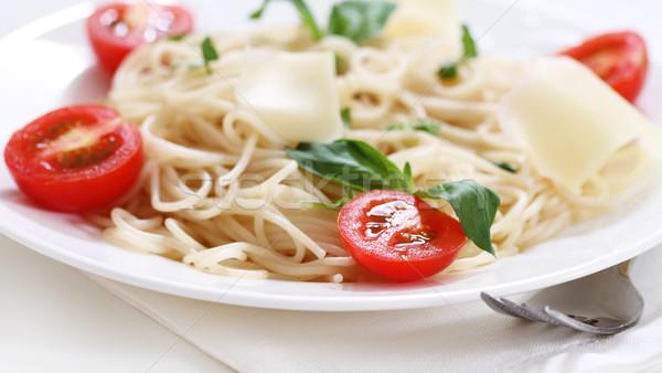 Spagetti domates parmesan peyniri pesto sos kiraz domates Stok fotoğraf © dashapetrenko