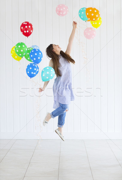 Happy young teen girl with helium air balloons Stock photo © dashapetrenko