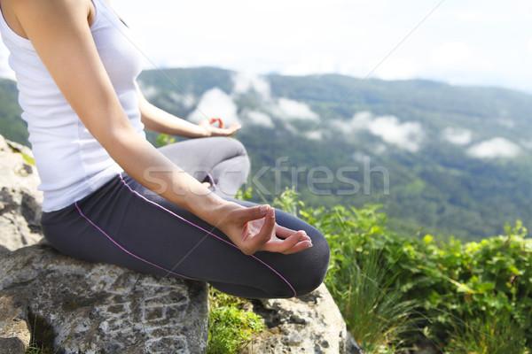Attractive young woman doing a yoga pose for balance  Stock photo © dashapetrenko