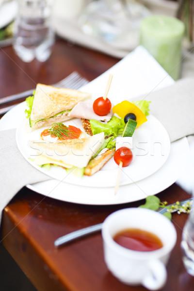 Assorted snacks on the plate Stock photo © dashapetrenko