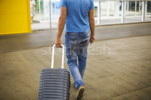 Young man with suitcase at airport or station  Stock photo © dashapetrenko