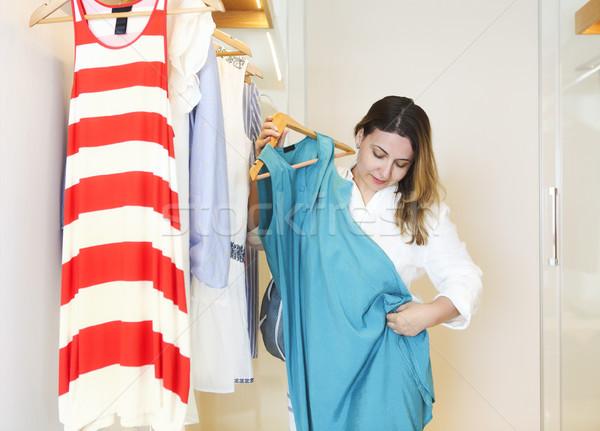 Young woman try on dress Stock photo © dashapetrenko
