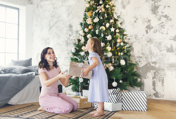 Cheerful mom and her cute daughter girl exchanging gifts Stock photo © dashapetrenko