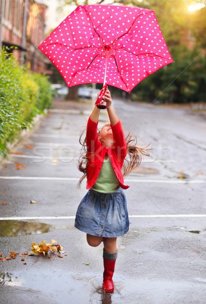 Gyermek pöttyös esernyő visel piros eső Stock fotó © dashapetrenko