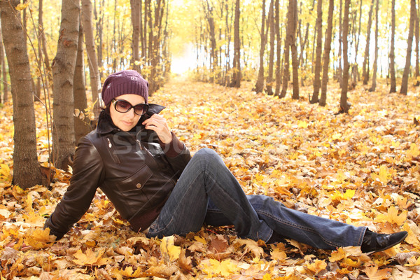 Young attractive woman in sun glasses in park  Stock photo © dashapetrenko