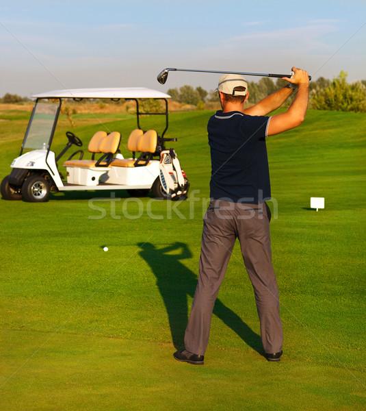 Athletic young man playing golf Stock photo © dashapetrenko