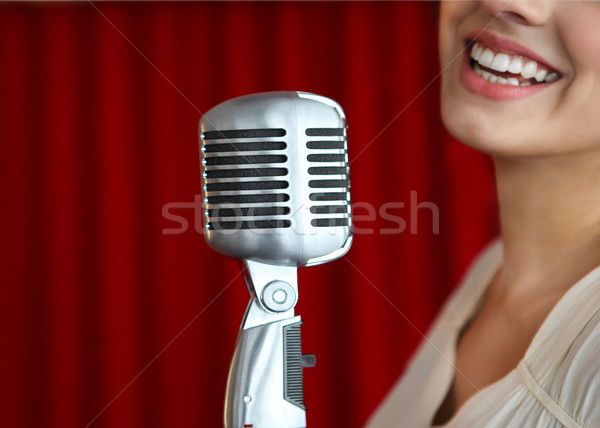Beautiful woman singing with the microphone Stock photo © dashapetrenko