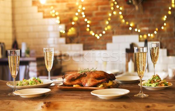Zimą wakacje rodziny obiedzie drób szampana Zdjęcia stock © dashapetrenko