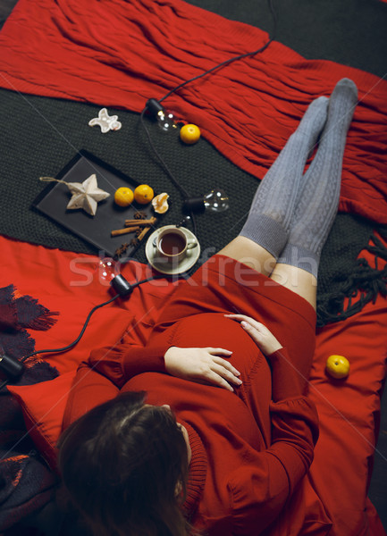 Young pregnant woman in red dress with tea cup Stock photo © dashapetrenko