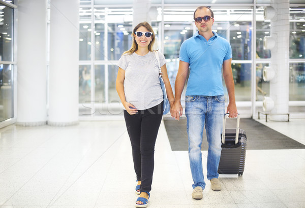 Pregnant couple with suitcase at airport or station  Stock photo © dashapetrenko