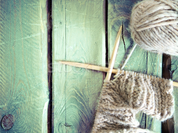 Colorful ball of yarn and knitting on a wooden table Stock photo © dashapetrenko