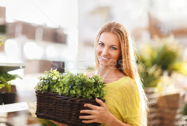 Young woman buying flowers at a garden center Stock photo © dashapetrenko