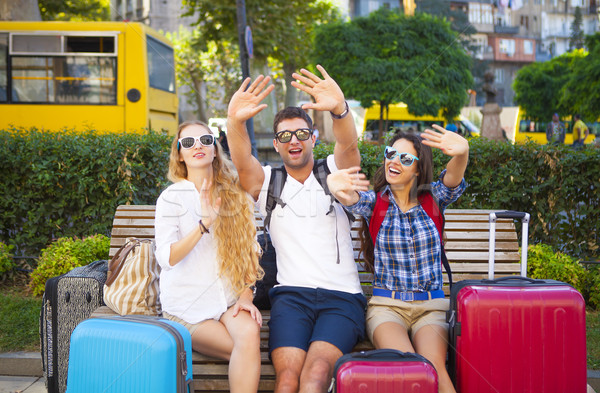 Travelers friends with luggage in the city Stock photo © dashapetrenko