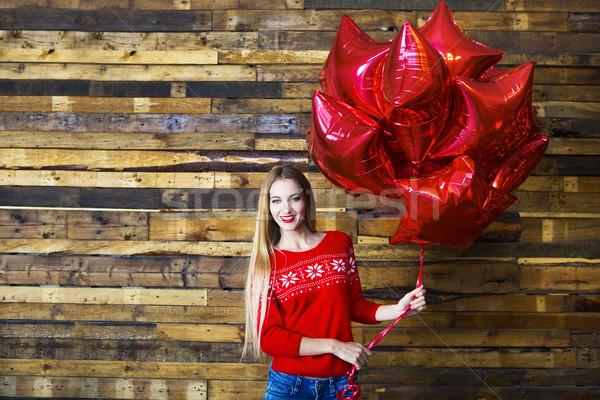 Happy woman with holding red balloons Stock photo © dashapetrenko