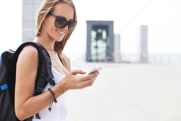 Young girl traveler with backpack looking on phone Stock photo © dashapetrenko