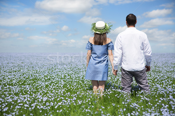 Happy beautiful pregnant couple in linen field Stock photo © dashapetrenko