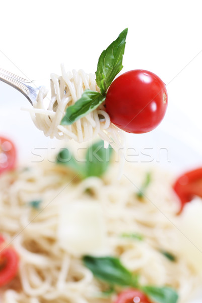 Spaghetti, basil and tomato on fork Stock photo © dashapetrenko