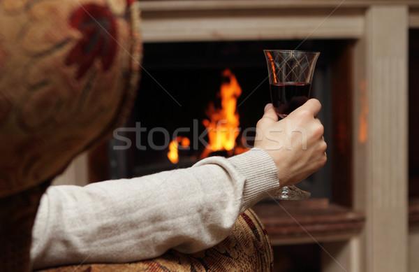 Vörösbor kandalló férfi üveg háttér szék Stock fotó © dashapetrenko