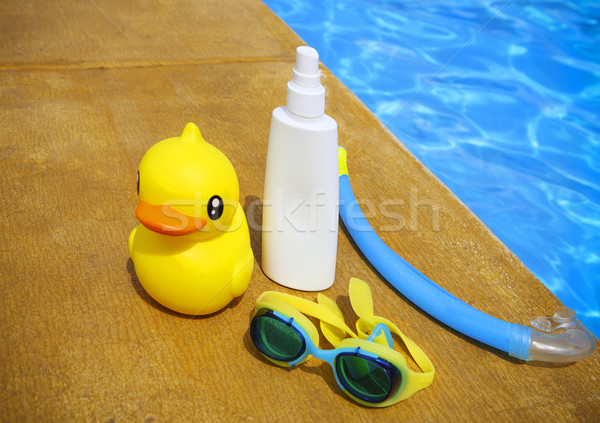 Suncream, snorkel, goggles and yellow rubber duck Stock photo © dashapetrenko
