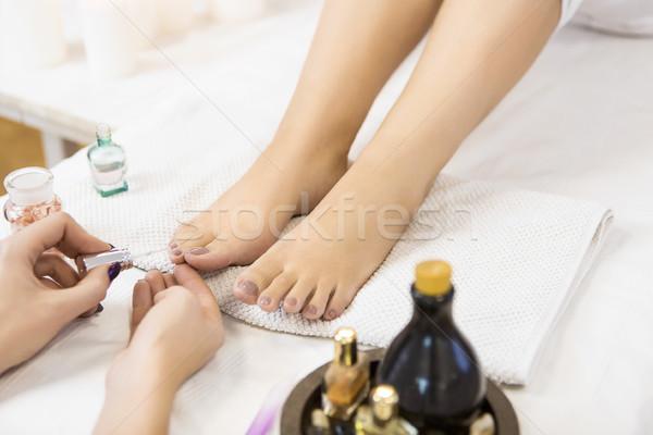 Pedicure at beauty salon. Nail polishing. Close up. Stock photo © dashapetrenko
