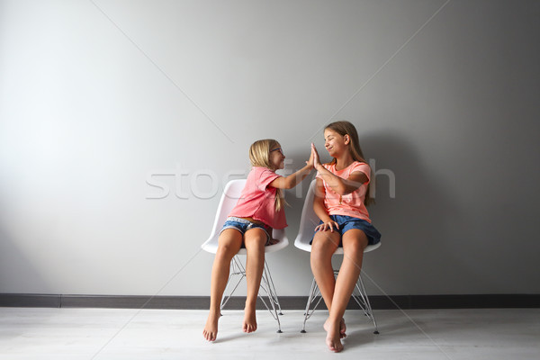 Happy girl in a discussion with her little. Problems decision be Stock photo © dashapetrenko
