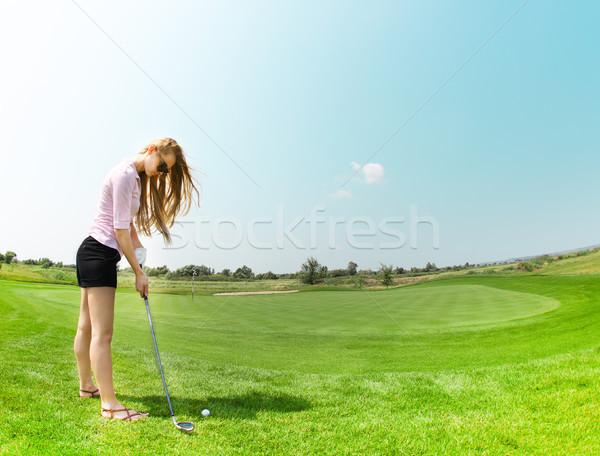 Feminino jogador de golfe bola menina golfe Foto stock © dashapetrenko