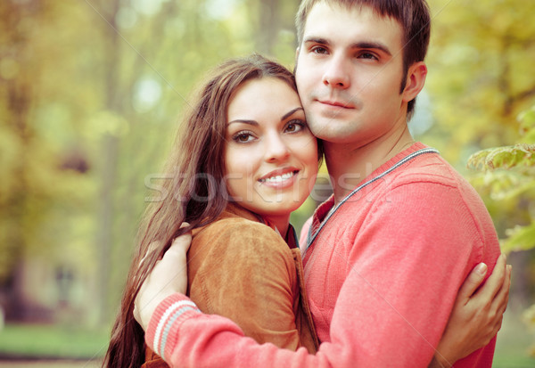 Portrait of couple enjoying golden autumn fall season Stock photo © dashapetrenko