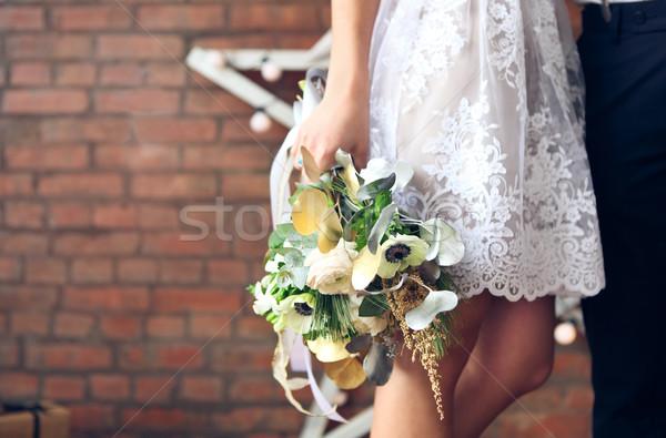 Cheerful married couple with wedding bouquet Stock photo © dashapetrenko