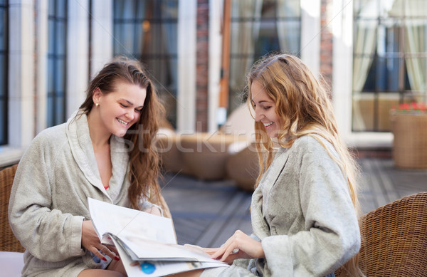 Two young women relaxing in the spa resort reading the magazine  Stock photo © dashapetrenko