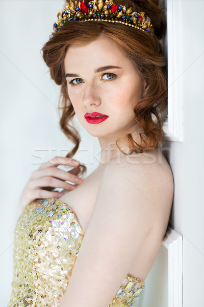 Beautiful redhaired fashion model posing in evening dress and in Stock photo © dashapetrenko