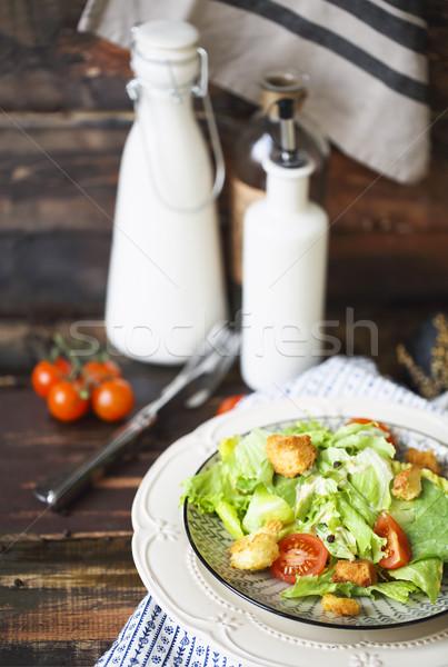 Egészséges grillcsirke cézár saláta sajt fa asztal levél Stock fotó © dashapetrenko