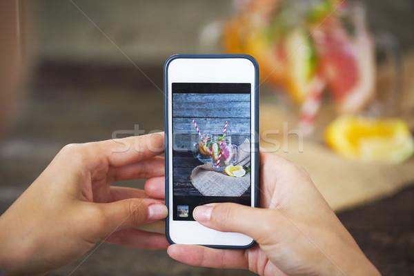 Taking photo of freshly squeezed lemon juice in glasses Stock photo © dashapetrenko